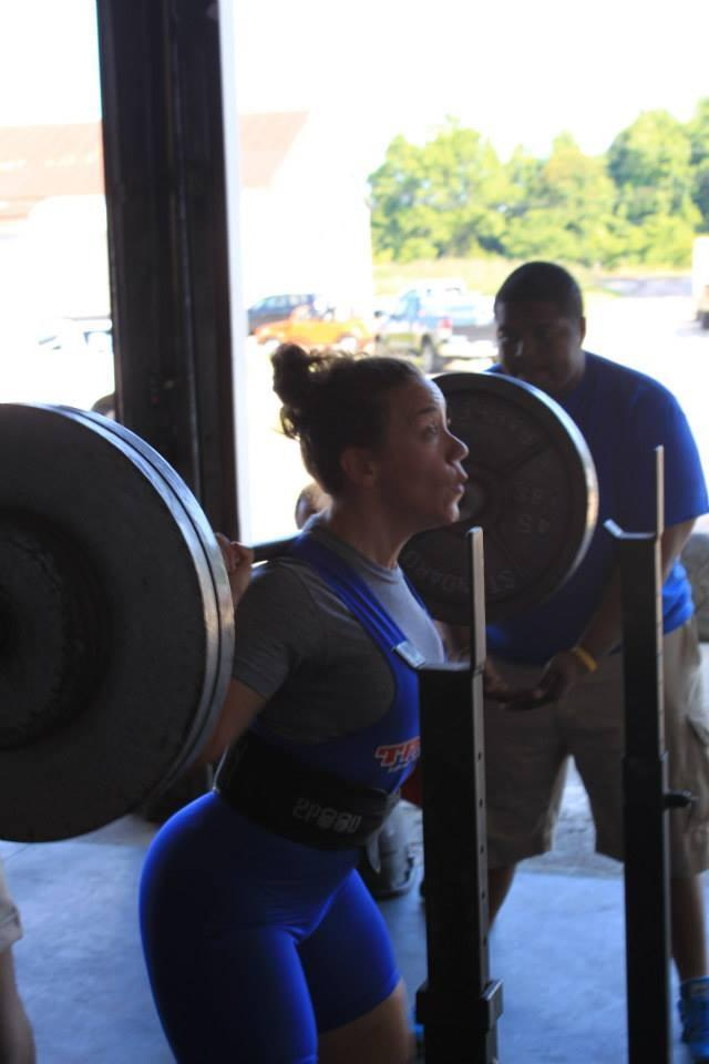 Coach Amber squatting 123 at 71 winning the State Games in 2013. Photo credit: Leslie Lee