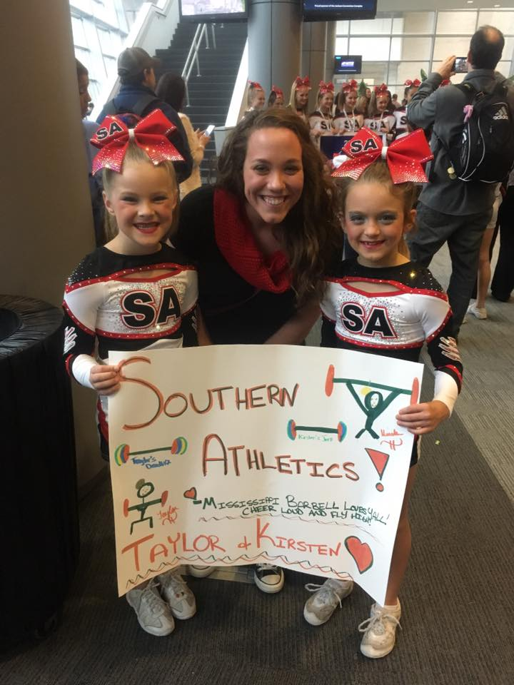 9 year old youth athletes TG and KD with Coach Amber after their local cheerleading competition.