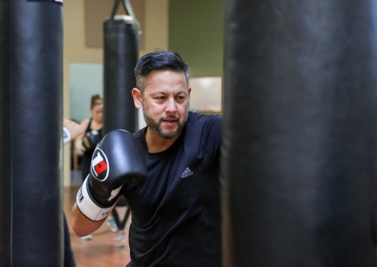 Punching the bag in Kickboxing class at Tao San Fit-Boxing & Self-Defense, Santa Cruz.jpg