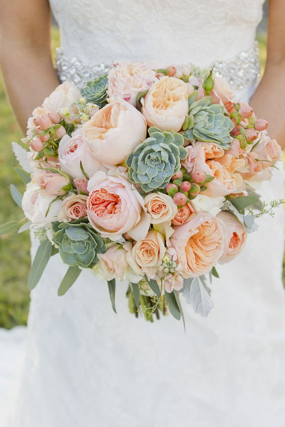 Peach freesia and rose succulent wedding bouquet