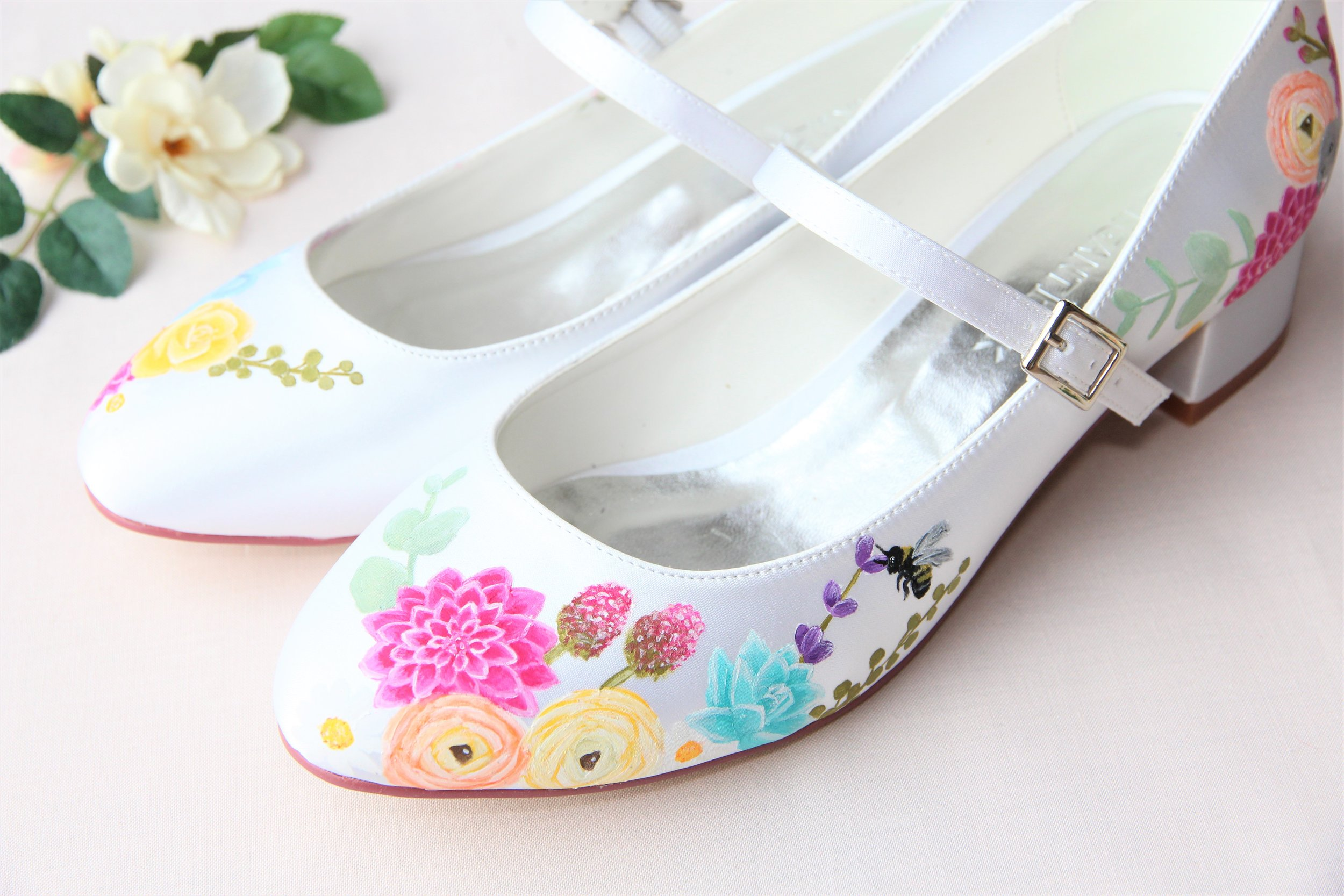 hand painted floral print block heel shoes with bumble pee detail