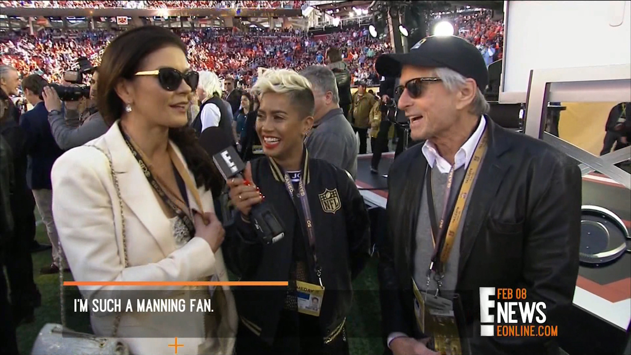 Catherine Zeta-Jones & Michael Douglas with E!'s Sibley Scoles during Super Bowl 50 Pre-Game.