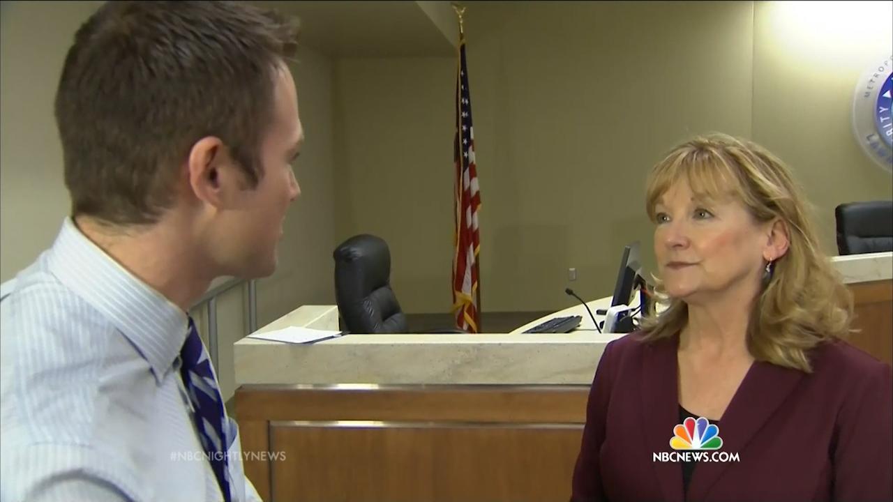 NBC reporter Blake McCoy interviews school administrator.