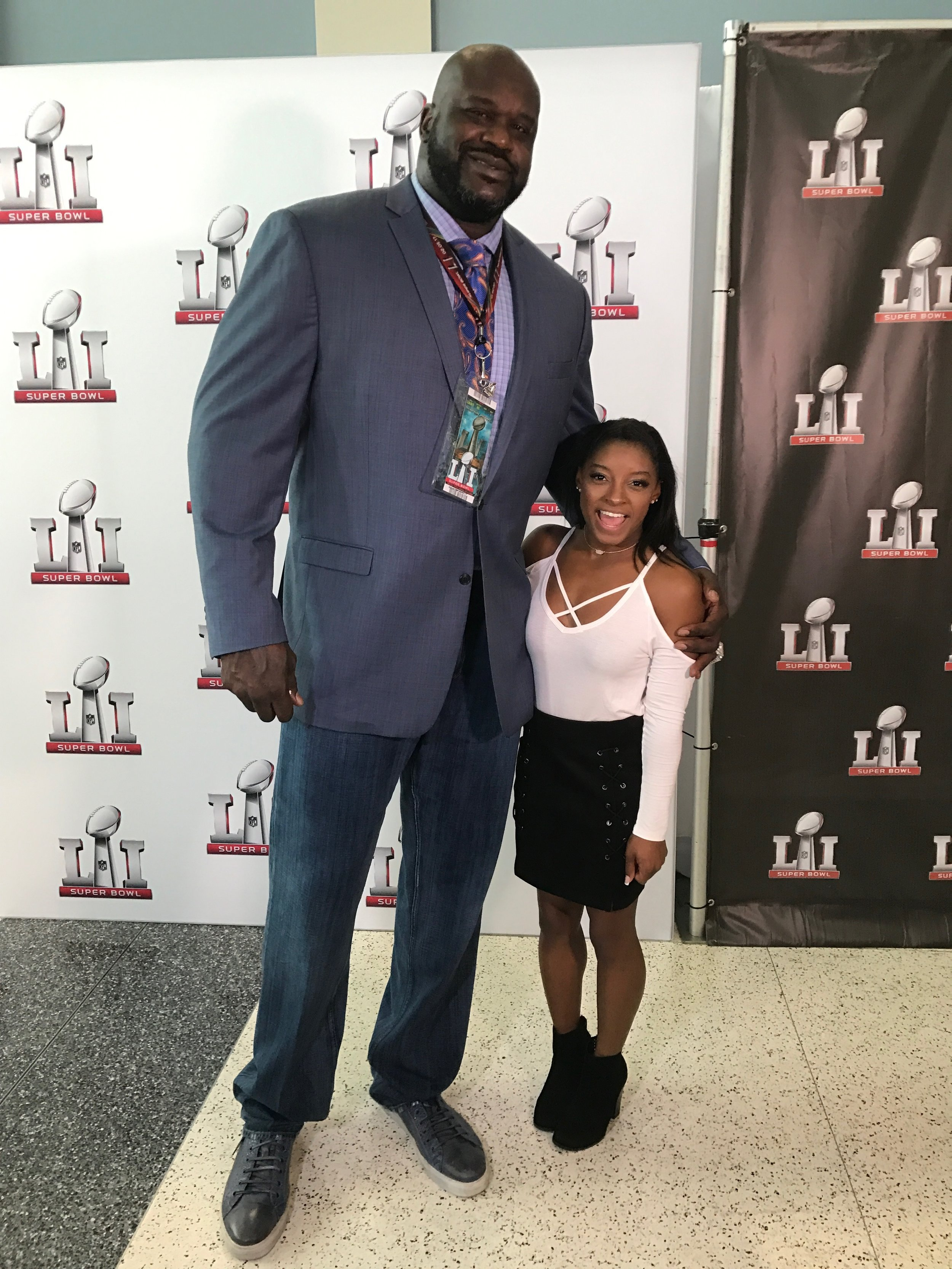 "This is an amazing picture E! producer James Chairman snapped of 7'1"" Shaquille O'Neal and 4'9"" Olympian Simone Biles before Super Bowl 51 in Houston."