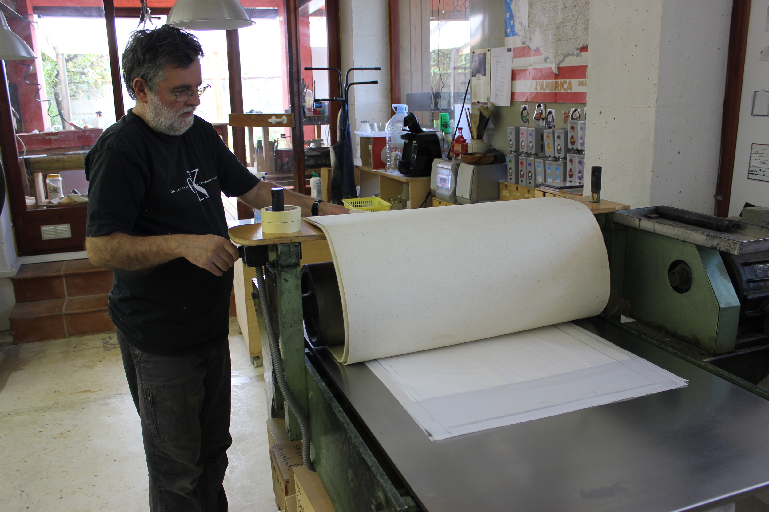Jordi operating the press