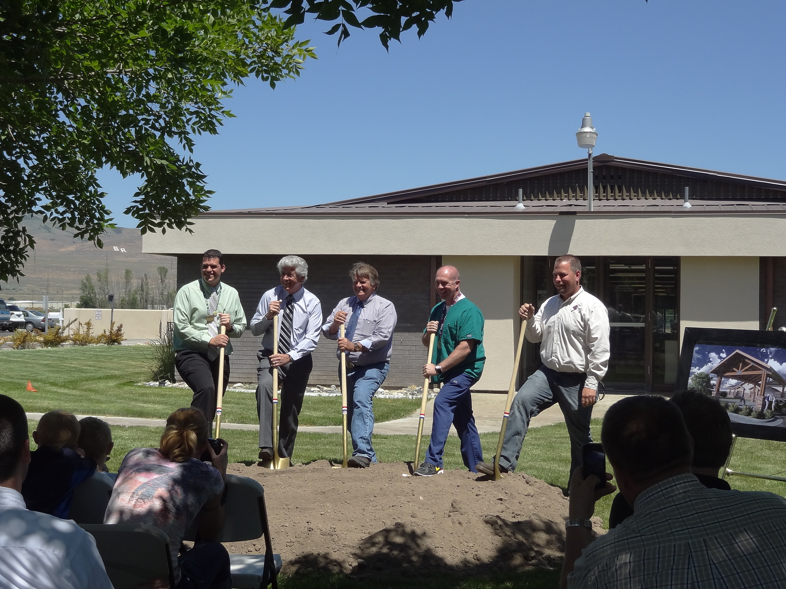 Turning shovels of dirt, from left to right: Brandon Sturdevant, Administrator of Bear River Valley Care Center, Gary Kelso, President and CEO of Mission Health Services, Mayor Roger Fridal, the director of nursing for Bear River Valley Care Center, and Cole Knighton, Project Manager for Spindler Construction