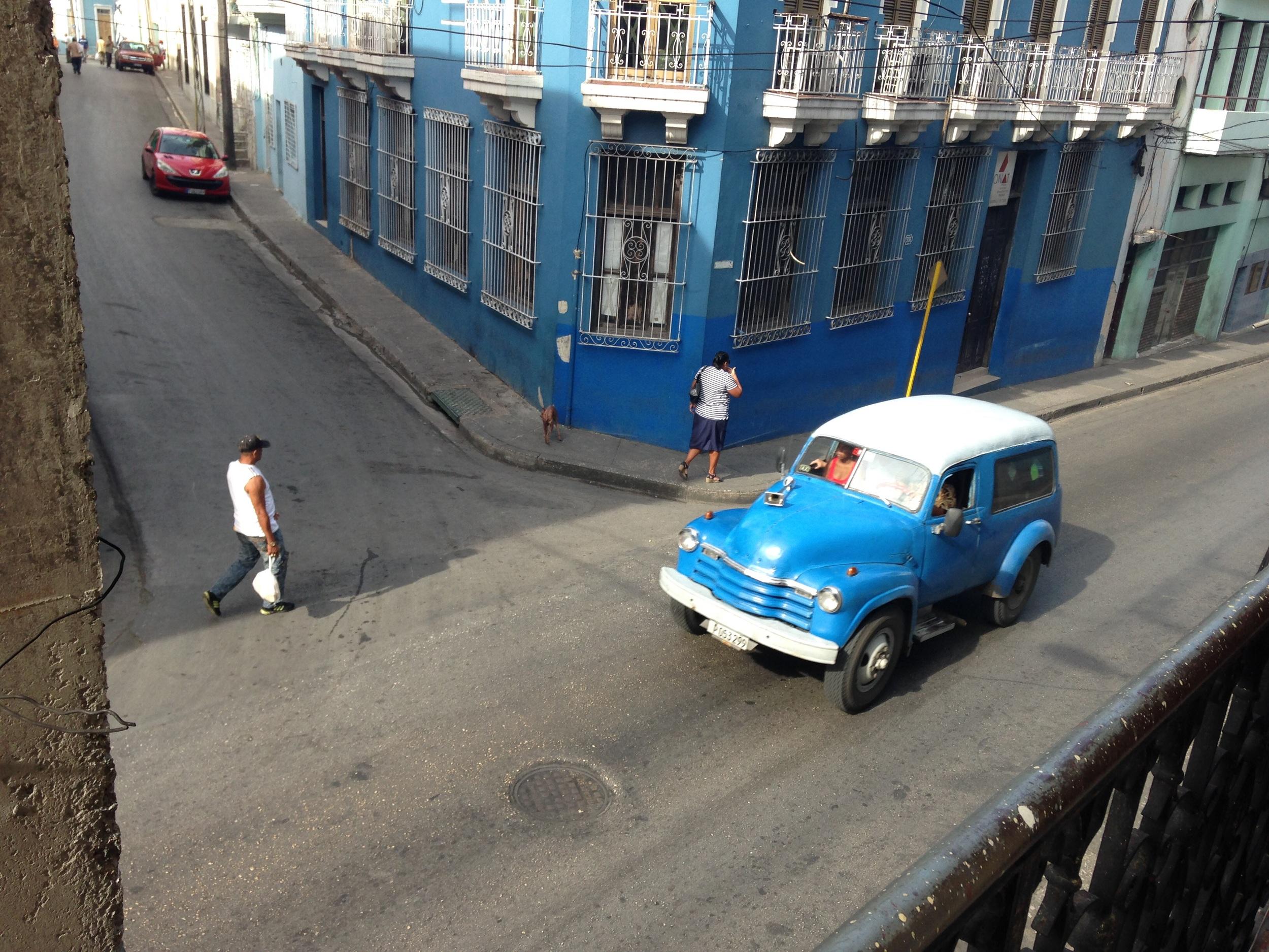 Old car and street view in Santiago de Cuba