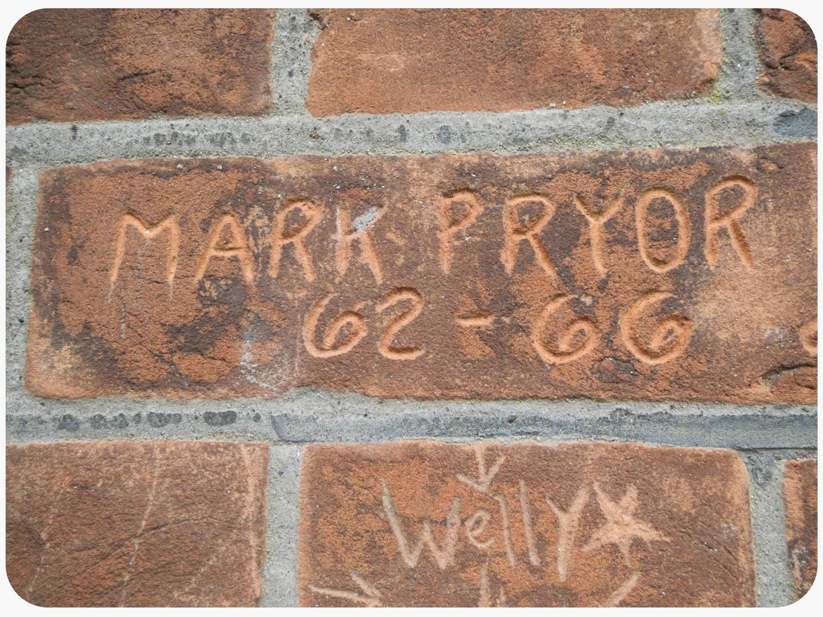 Upon graduation, all students sign the brick wall