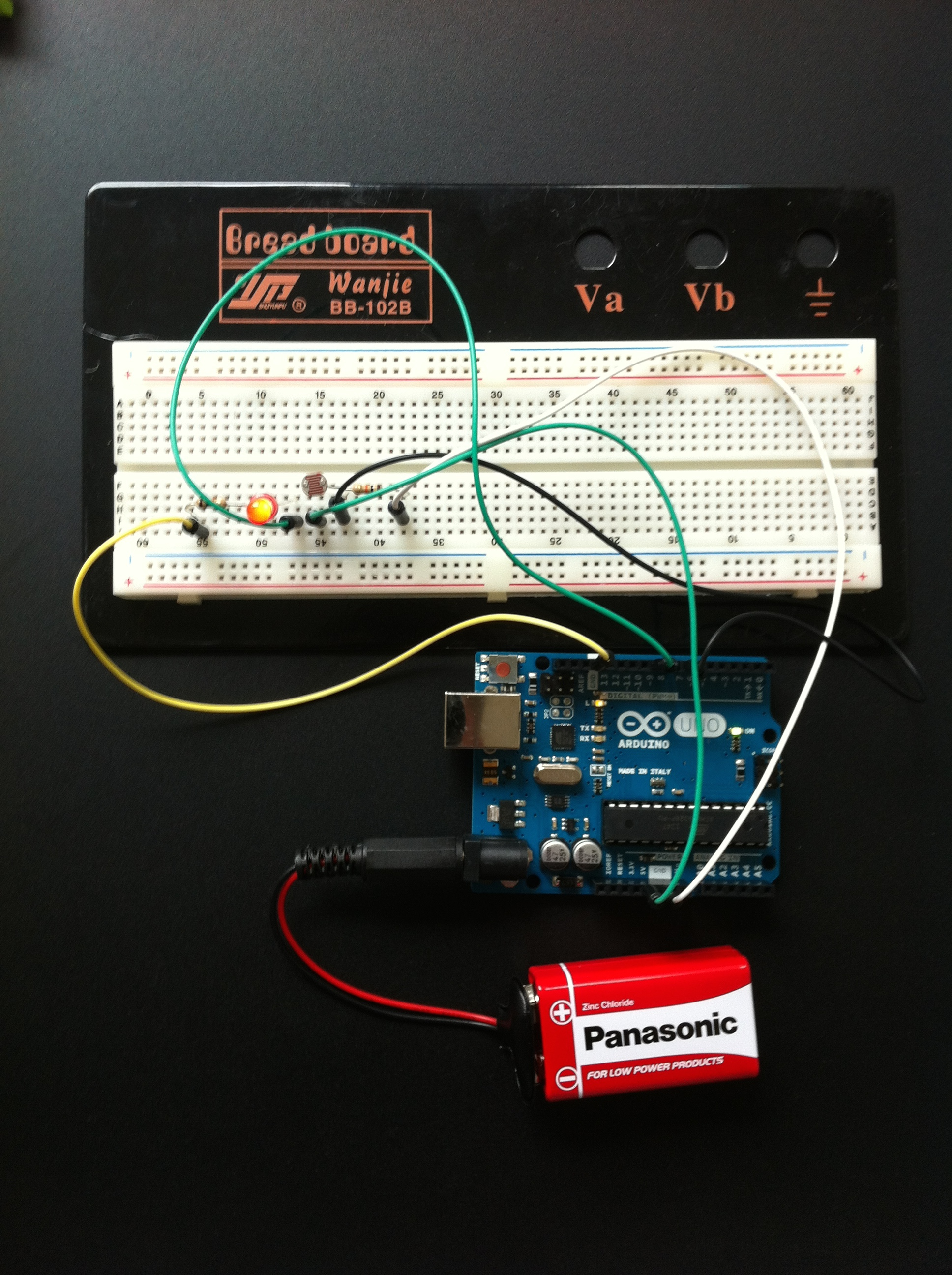 Arduino and breadboard wired LED with light sensor activation