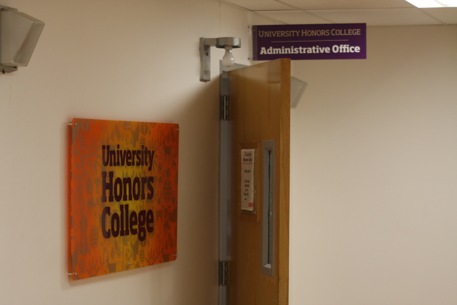 Hand spray painted sunburst, stenciled iconography, vinyl lettering and blade sign for University Honors College.
