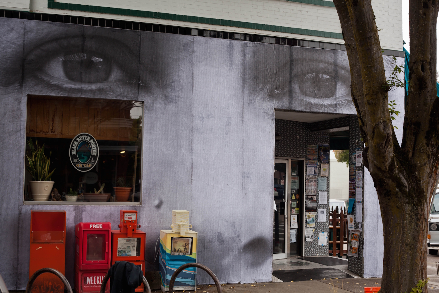 Large wheat paste installation at Squirrels in downtown Corvallis.