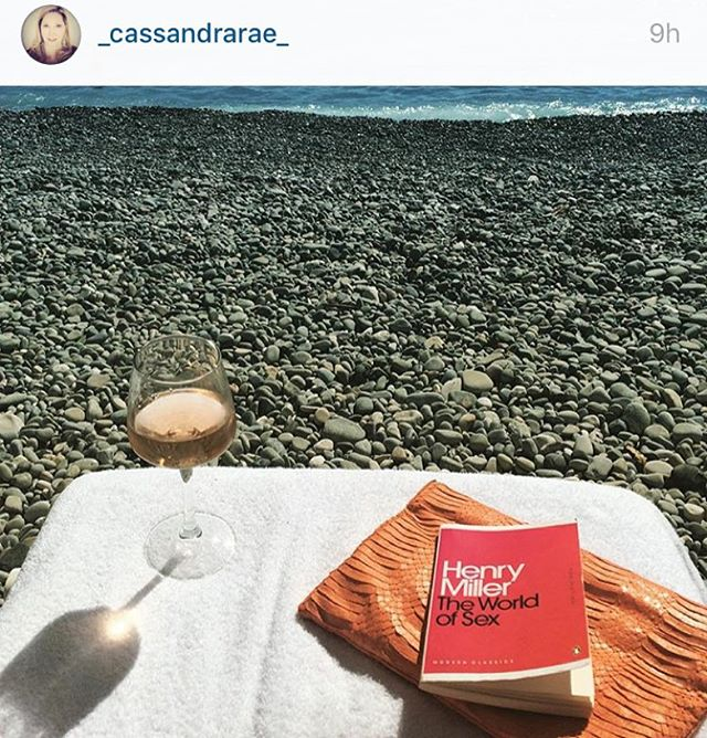 Crazy about this photo from one of the sexiest and smartest, @_cassandrarae_ ... Her Deux Cuirs snakeskin clutch in SUCH great company. #regram #henrymiller #sexonthebeach #womensaccessories #southoffrance #sundayreading