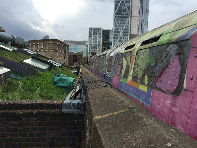 Living rooftop in London with old subway cars repurposed as artist studios reminds me of Bushwick
