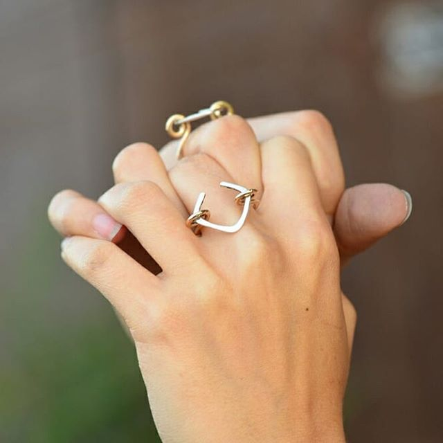 """Think Outside the Box""💍 is back in stock for Virtu Art Festival this weekend!😄🍾 I just found out today I'm booth #22, near the water fountain. Sorry for not posting often, 2018 has been.. intense 😅 Family + restructuring this business (a lot is in progress!) + wedding/ travel planning for everyone has been STRESSFUL😥 I honestly didn't have the time or energy to keep up with Instagram and got out of the habit. And for that I'm sorry. Bear with me, I'll try to get back into it! . . . #LivandLov #virtuartfestival #westerlyri #thinkoutsidethebox #rings #silverandgold"