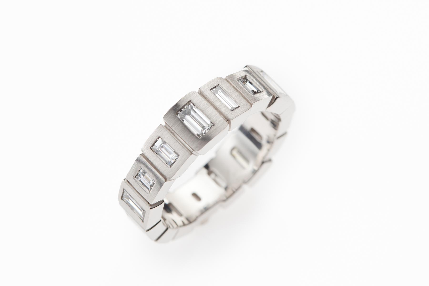 LUCIR: Diamond Baguette Eternity Ring in Platinum.