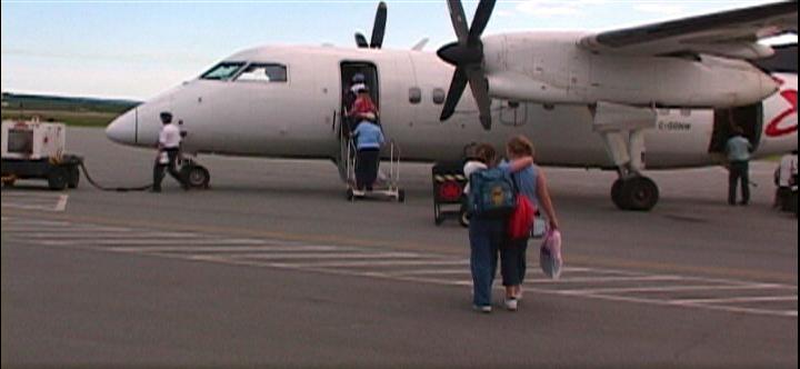 NG1 - Rebecca & Mariead walk to plane copy.png