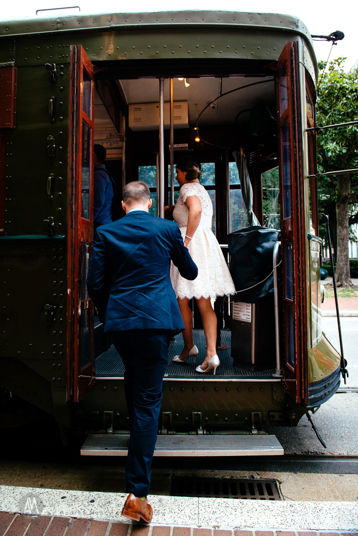 Taking their last few steps before becoming newlyweds aboard a New Orleans streetcar!