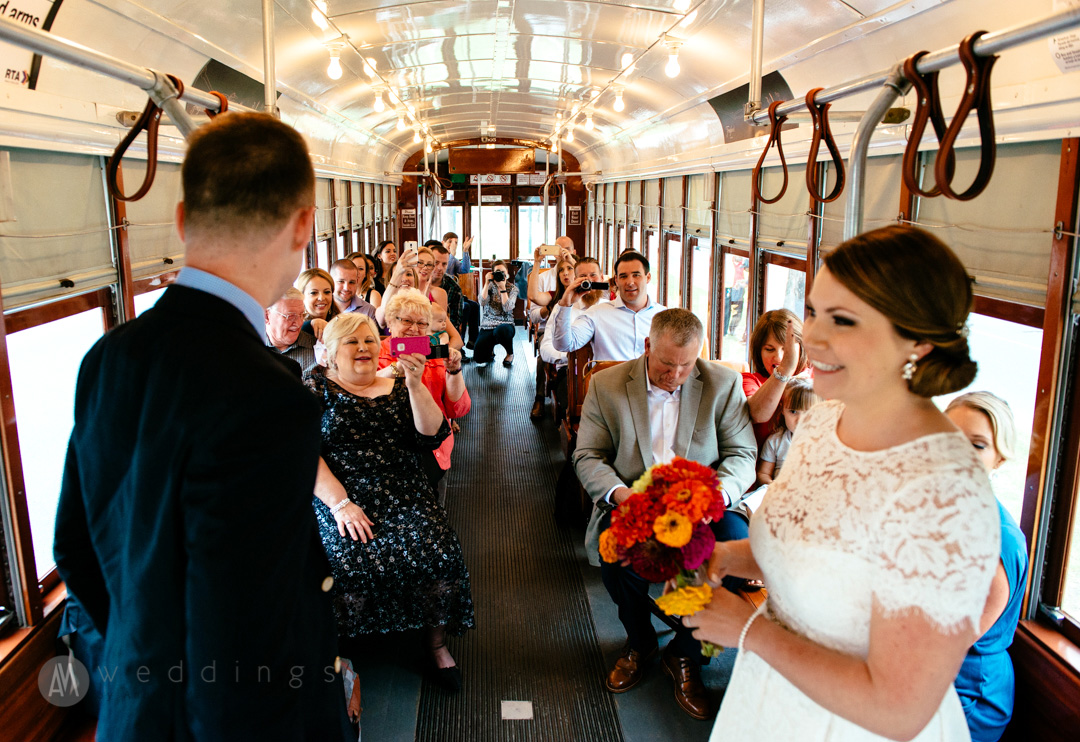 Corbie and Brian's first kiss concludes their wedding ceremony aboard the New Orleans streetcar. Having a streetcar wedding was perfect for an intimate ceremony, and made for a unique collection of photographs.