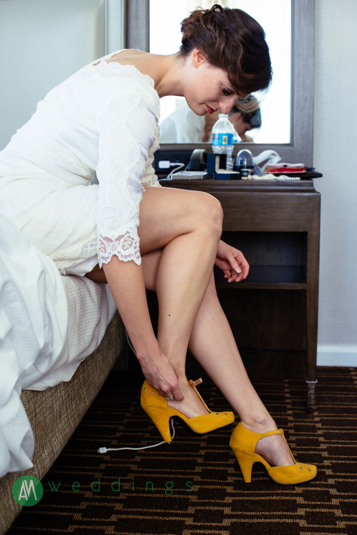 Georgia puts her shoes on in her room at the Hilton St. Charles before the wedding ceremony.