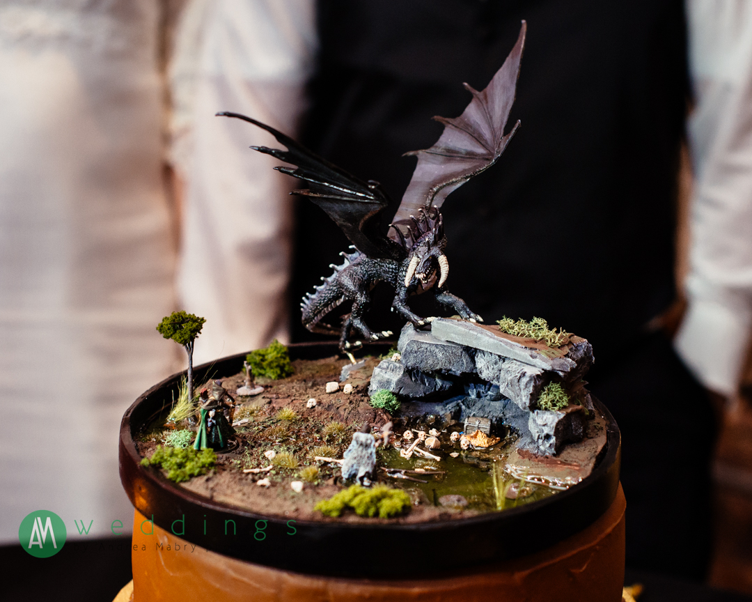 The bride's brother made this cake topper!Wedding reception at the New Orleans Wax Museum.