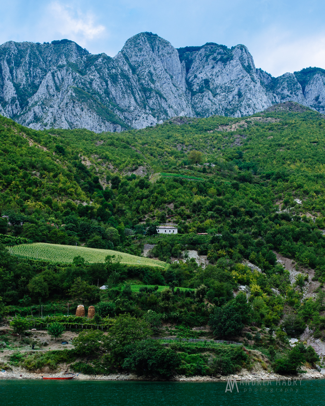 After riding in cars, boats, and buses around northern Albania, I think that if you ever wanted to disappear, you could easily do so there. We saw many houses like this one that are off on their own with no apparent road linking them to... anything.