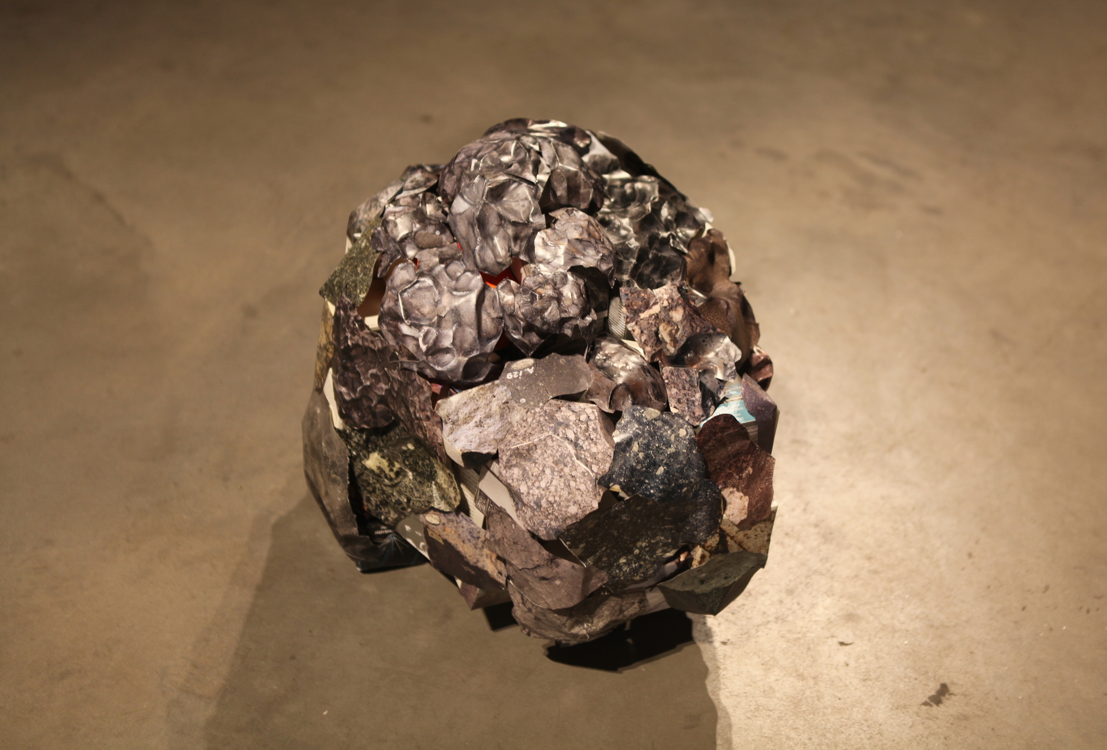 a meteorite-like object made out of books about meteorite, 30 x 30 x 30 inches