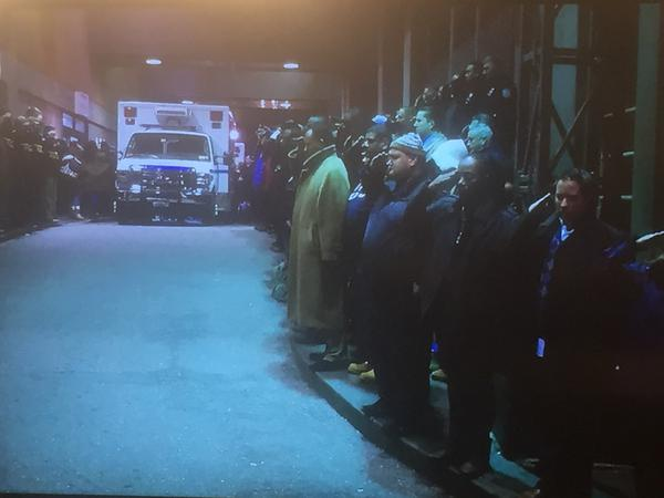 NYPD Patrol men line up and salute their two fallen comrades who were executed in Brooklyn