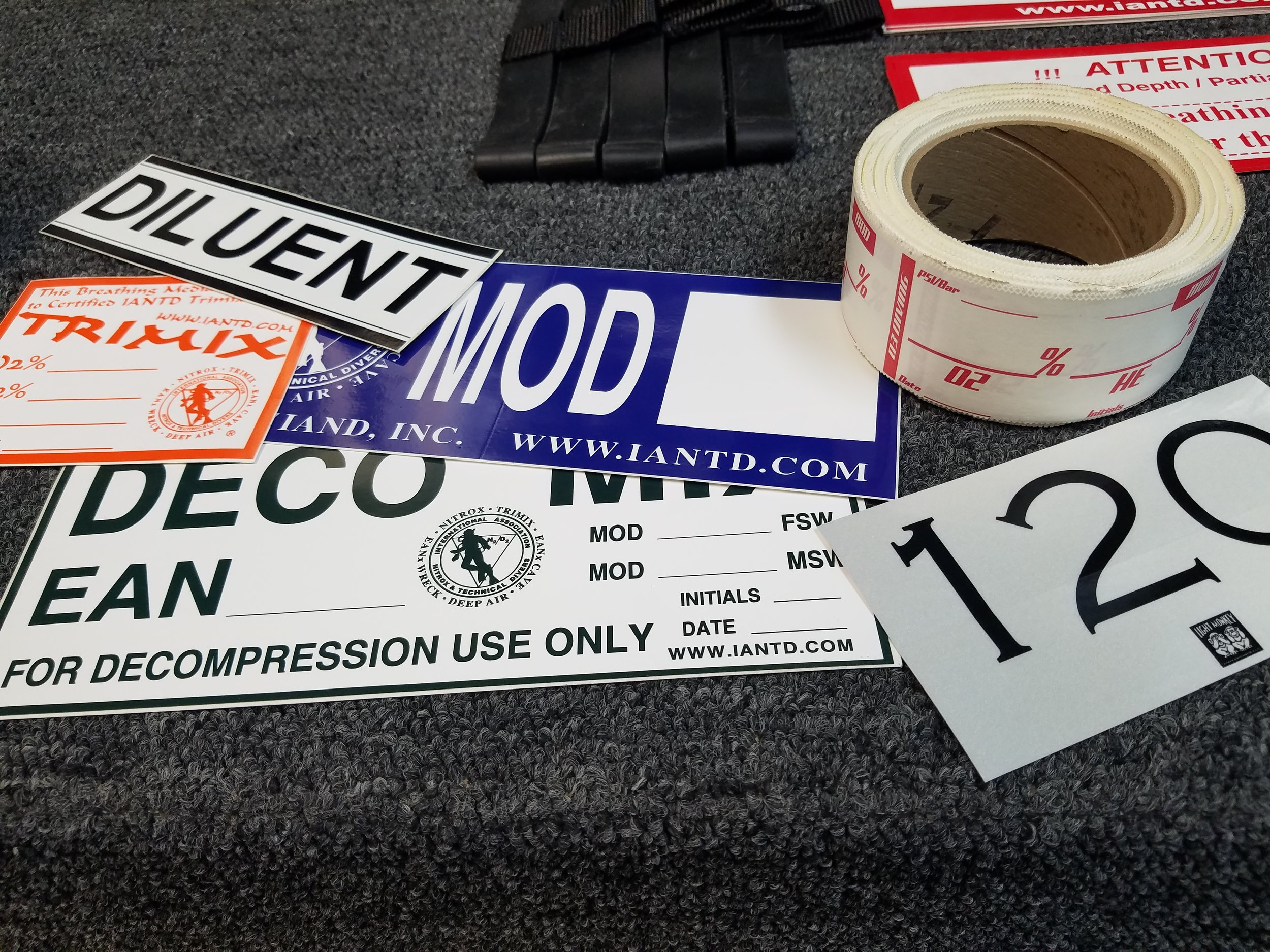 Labels for cylinders exist in many forms, at a minimum, a label with the percentage of oxygen and helium and the MOD should be in a spot on the cylinder clearly visible to all team members.