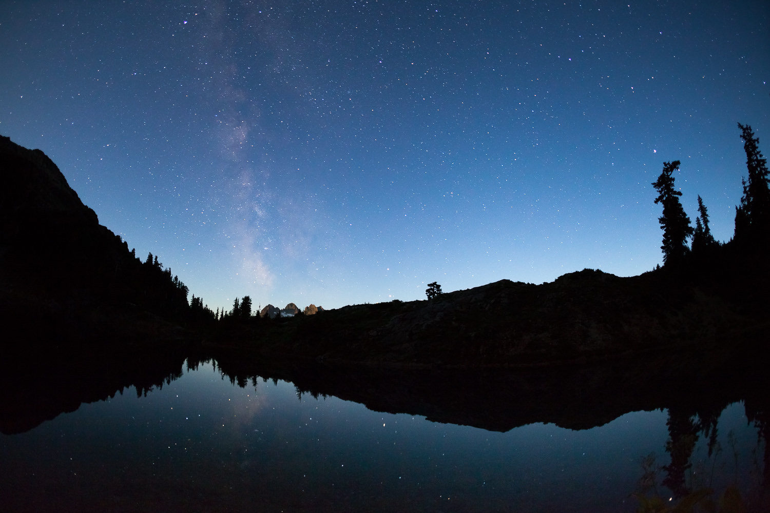 Milky Way over Cobalt Lake with Triple Peak lit in the background by the rising moon.