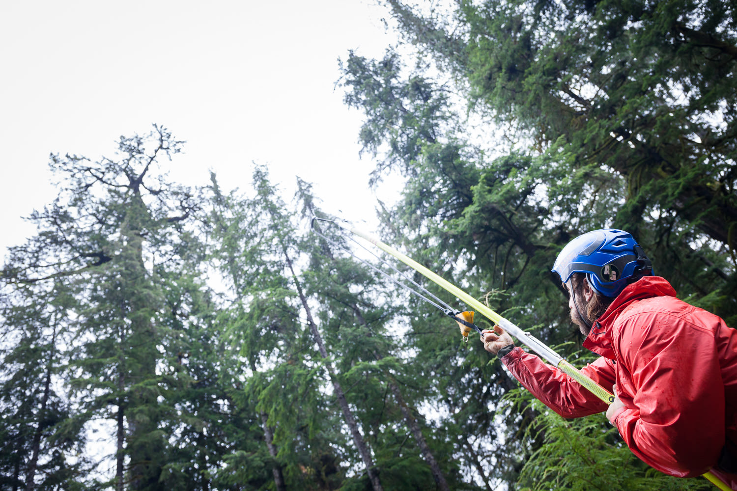 Matthew Beatty aims the Bigshot slingshot with the hopes of firing a bean bag over a large branch 200ft in the air.