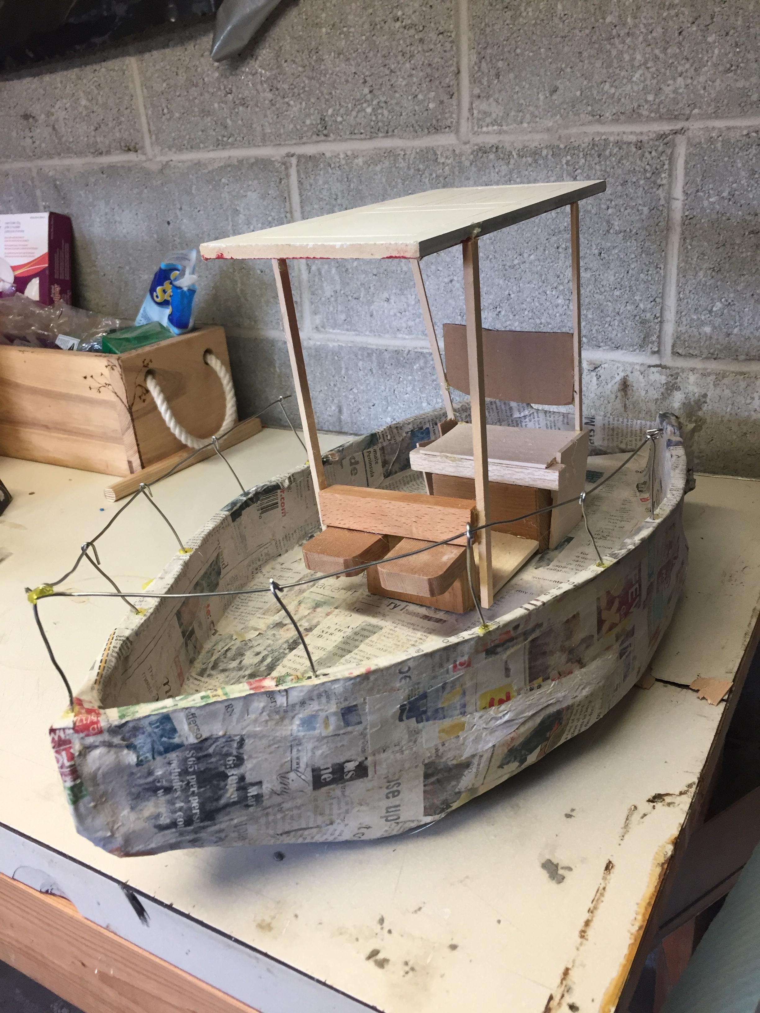 paper mache boat building.jpg