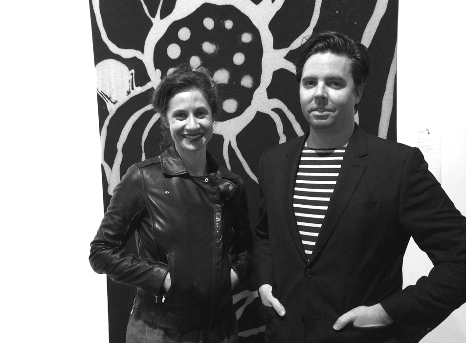 Amy Bernstein & Patrick Kelly at the Disjecta Art Auction in front of Jeffrey Kriksciun's textile // photo by Katie Bernstein