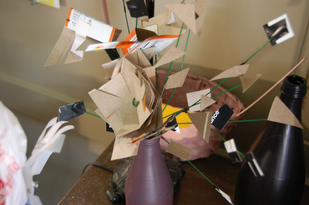 A cardboard flower arrangement in Jaik's studio