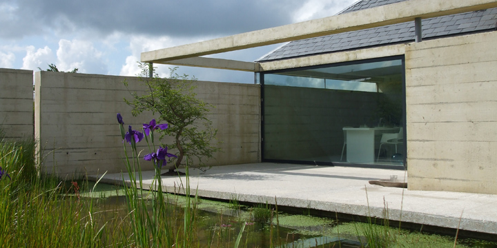 Bryncyn is a small, luxurious white cottage with a minimalist interior where tradition meets glass & concrete.