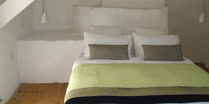 Master double bed upstairs with additional two single beds.