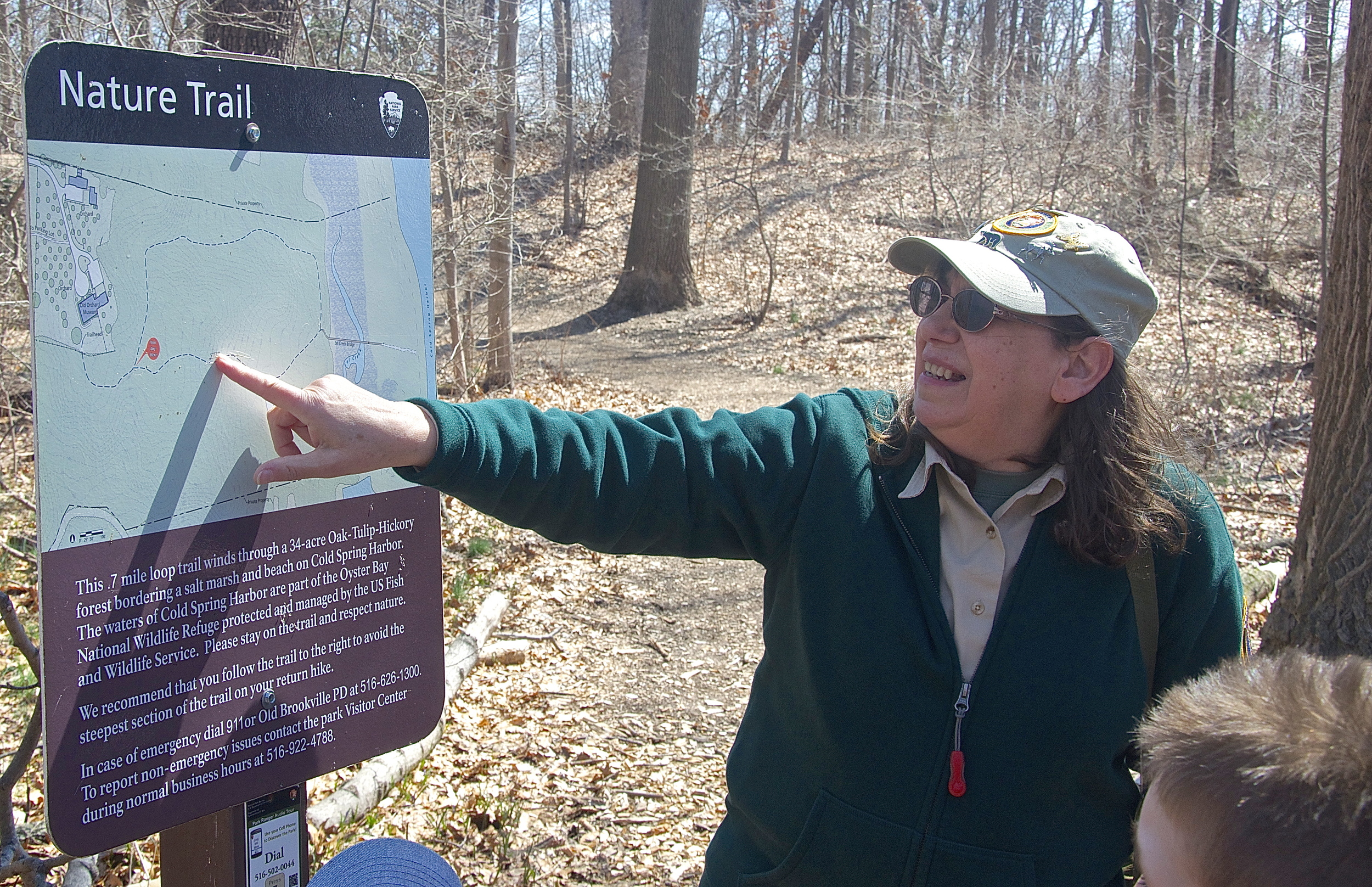 Naturalist Lois Lindberg pointed out the different trails for people that she led on a hike in the woods of Sagamore Hill Historic Park. (Photo: Joseph Kellard)