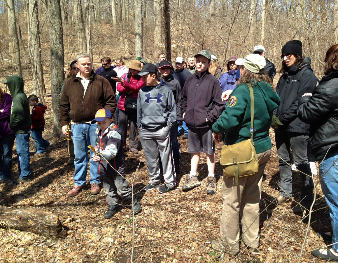 Naturalist Lois Lindberg, third from right, led 60 adults and children on an April Fool's Hike at Sagamore Hill National Historic Site on Saturday. (Photo: Joseph Kellard)