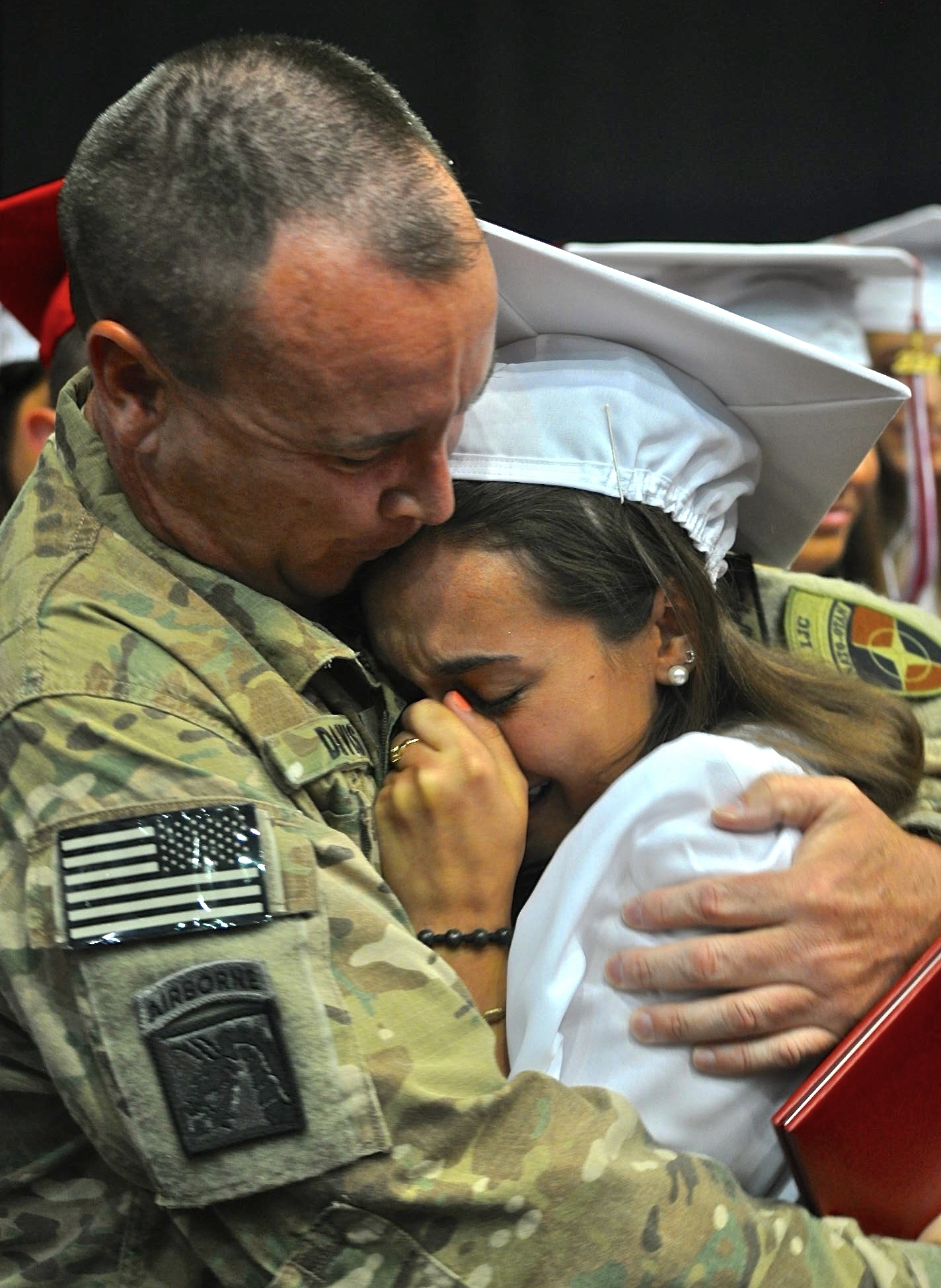 ARMY DAD & DAUGHTER REUNITE : This year's money shot shows a teen hugging her Army dad after he showed up at her high school graduation ceremony while she thought he was still stationed overseas. Newsday assigned me to cover this reunion and I made sure I found a good vantage point to capture this moment. Money!