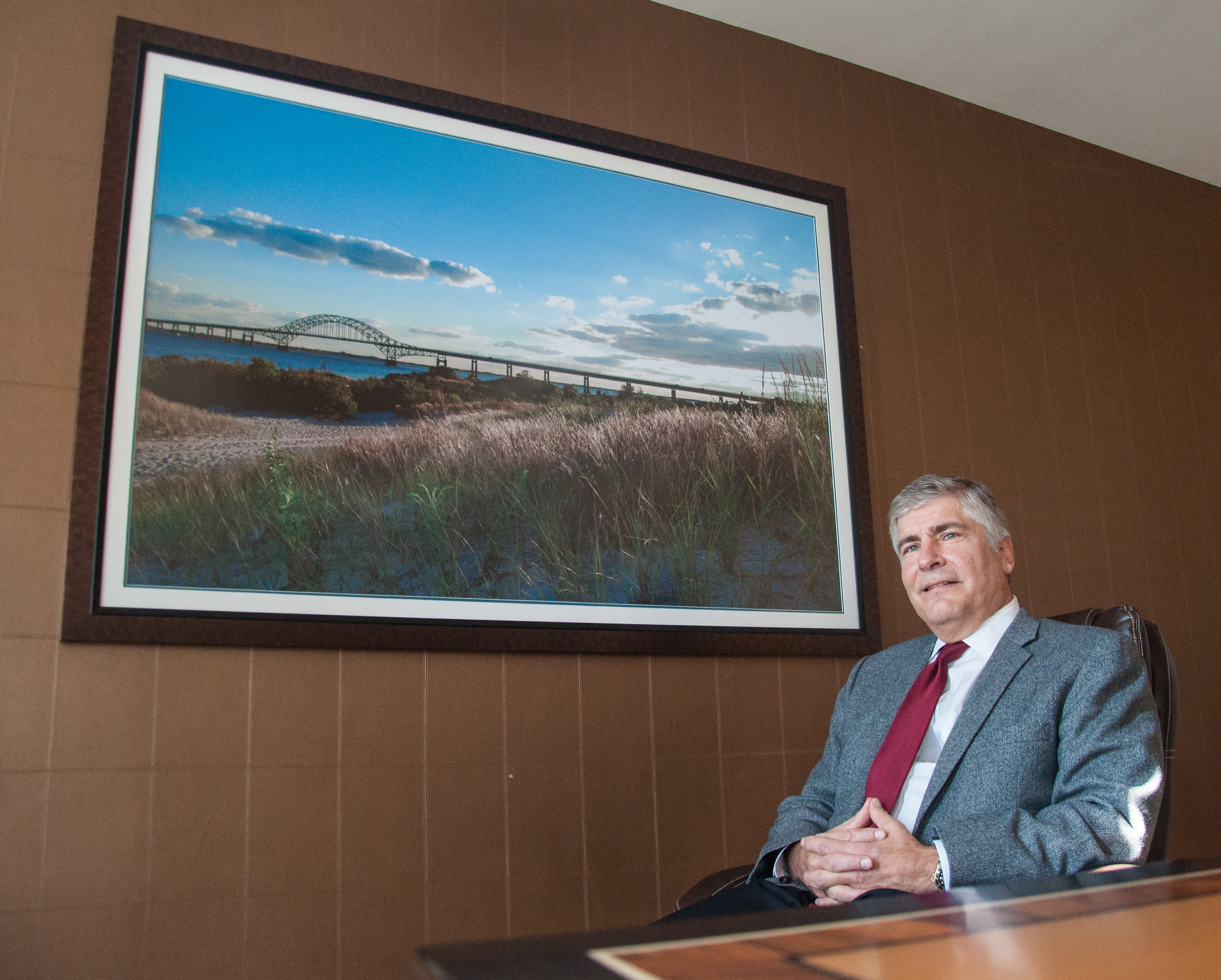 Leonard Bellavia sits in a meeting room at his law practice in Hauppauge, where he had photos of Long Island scenes installed throughout the office. (Photo: Joseph Kellard)