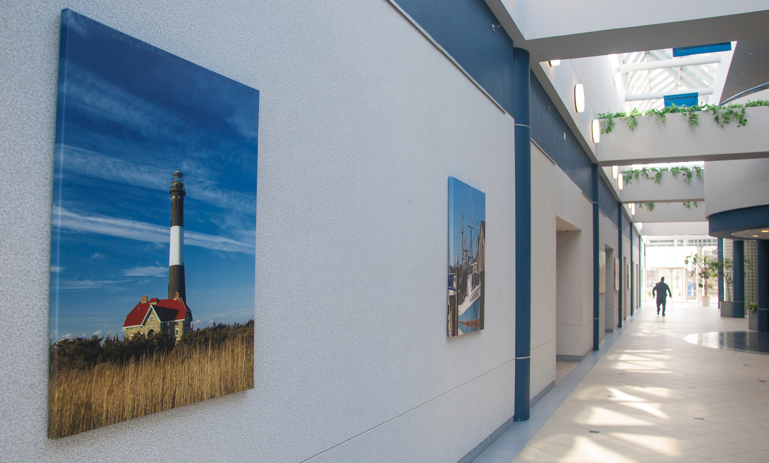 The atrium of an office complex in Melville has 13 photo canvases, including one of the Fire Island Lighthouse. (Photo: Joseph Kellard)