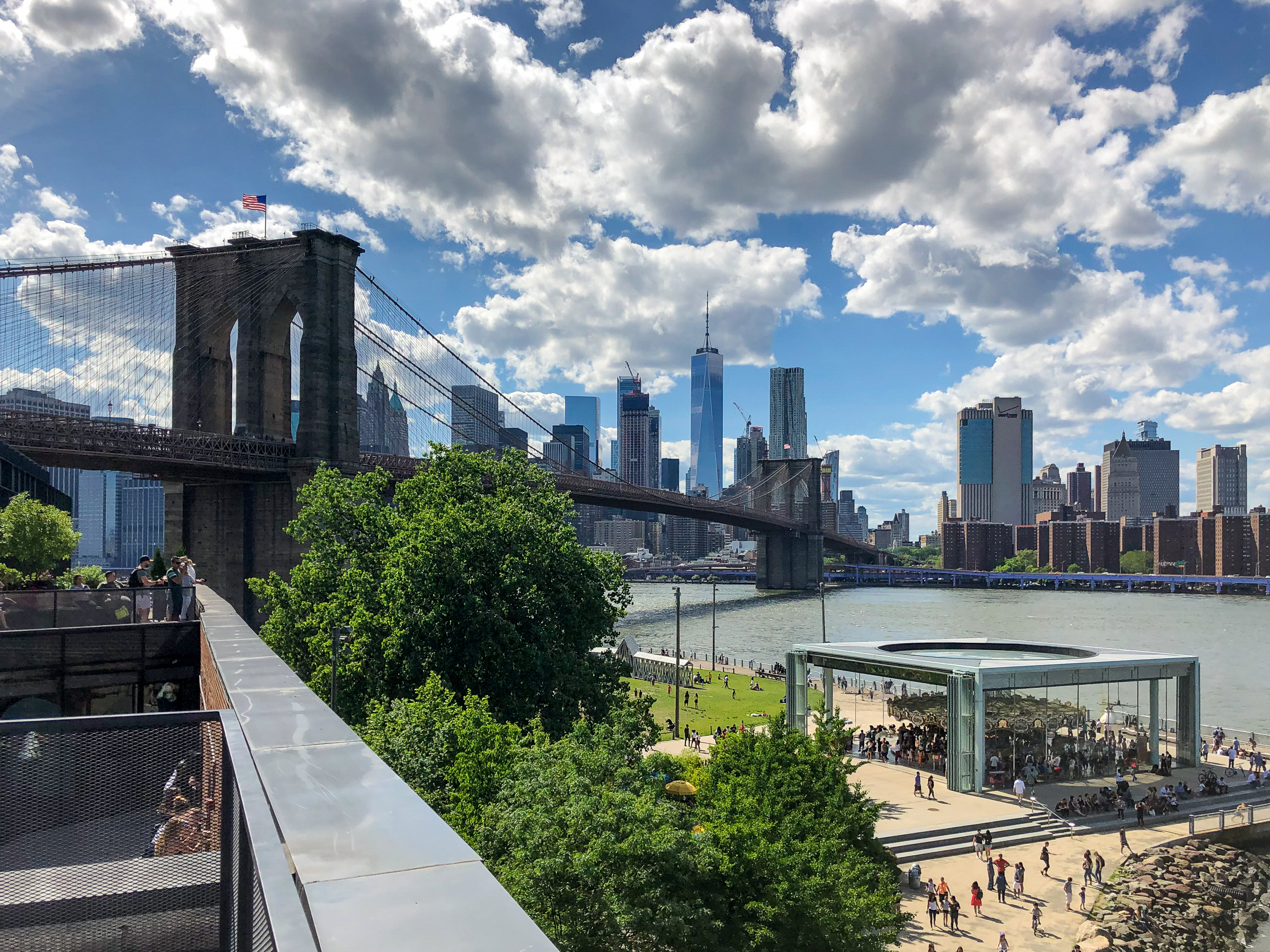 A panoramic of the Brooklyn Bridge, Lower Manhattan and Jane's Carousel in Empire Fulton Ferry Park that edges the East River. I snapped this shot from a new vantage point atop a terrace of the Empire Stores.