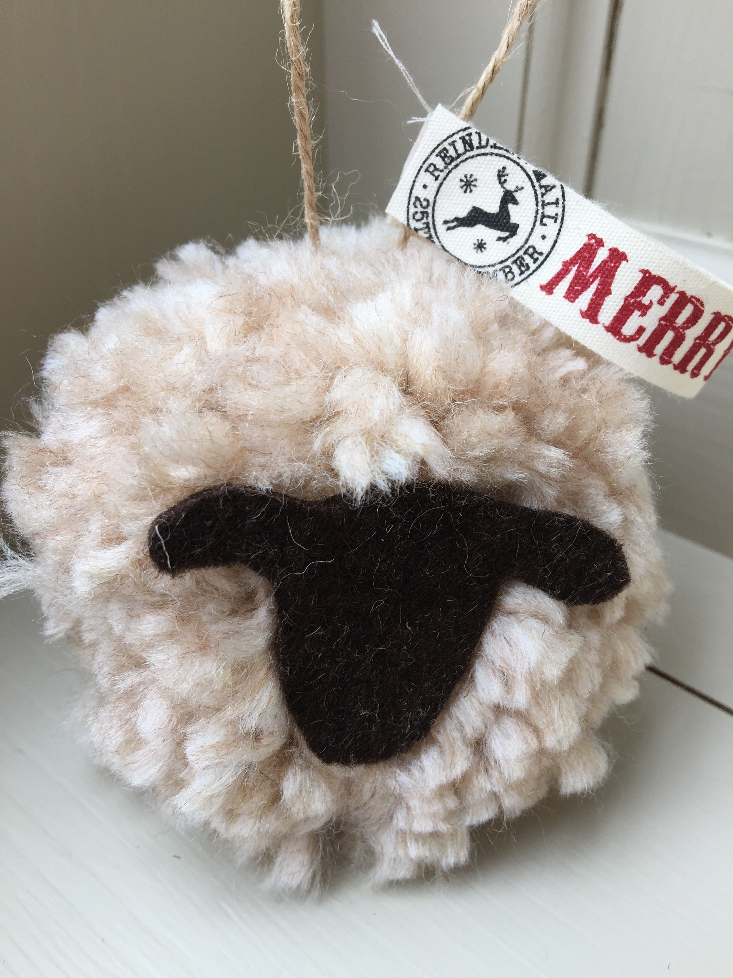 Giant sheep pom pom Christmas decorations : these large sheep hanging pom poms make a great hanging door decoration.  Made from wooden yarn they are around the size of a tennis ball (or a little larger ...)