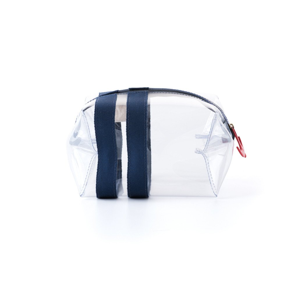Corroon - I Love TSA Bag  $40.00   A travel essential. Make your TSA moment stress free by having this boxy, clear plastic bag in hand.  Corroon is here to help you get from A to B with a little more style. The collection aspires to capture the sensibility of a bygone era and adds in modern and practical components for doing battle in today's airports, train stations and hotels.