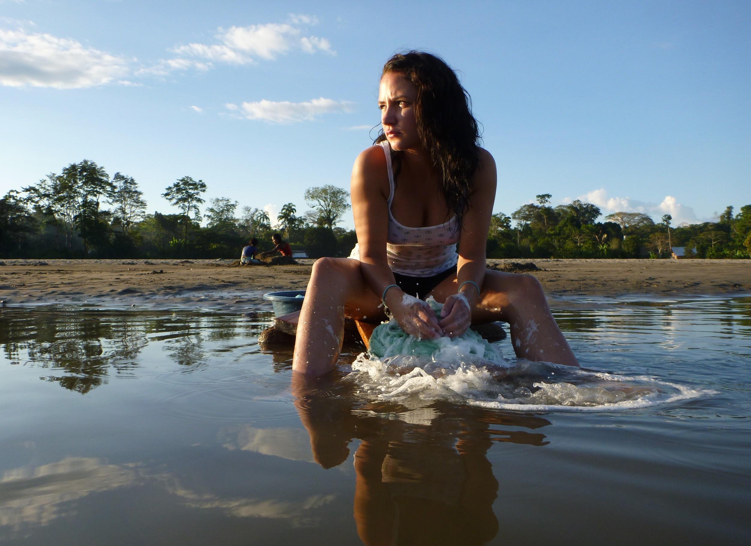 Sadie washing clothes in river - smaller.jpg