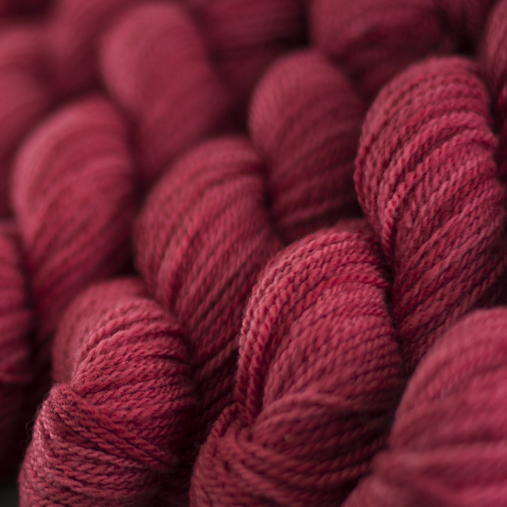 Rambouillet Sport in Cardinal is an immersion-dyed yarn.