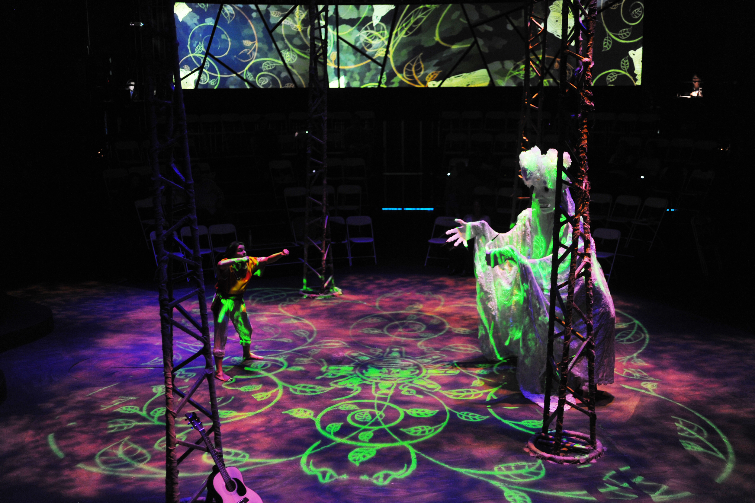 Scenic design by Jake Pinholster; Costume design by Connie Furr; Mask design by Zarco Guerrero; Lighting design by Celeste Brown; Media design by Daniel Fine with Matthew Ragan.Photo credit: Tim Trumble.