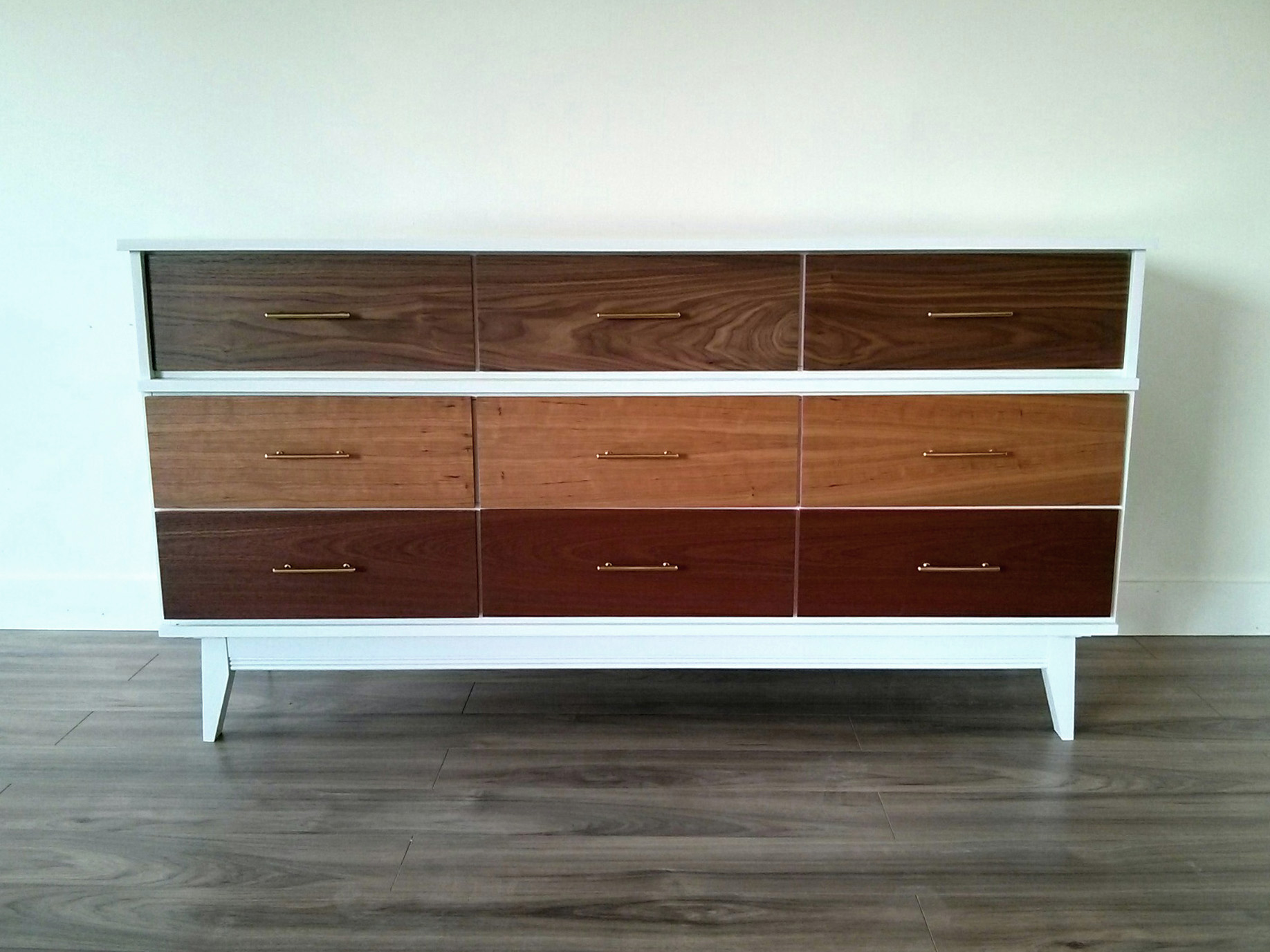 ...the wood grain travels from one drawer to the next....no repeats! ;)