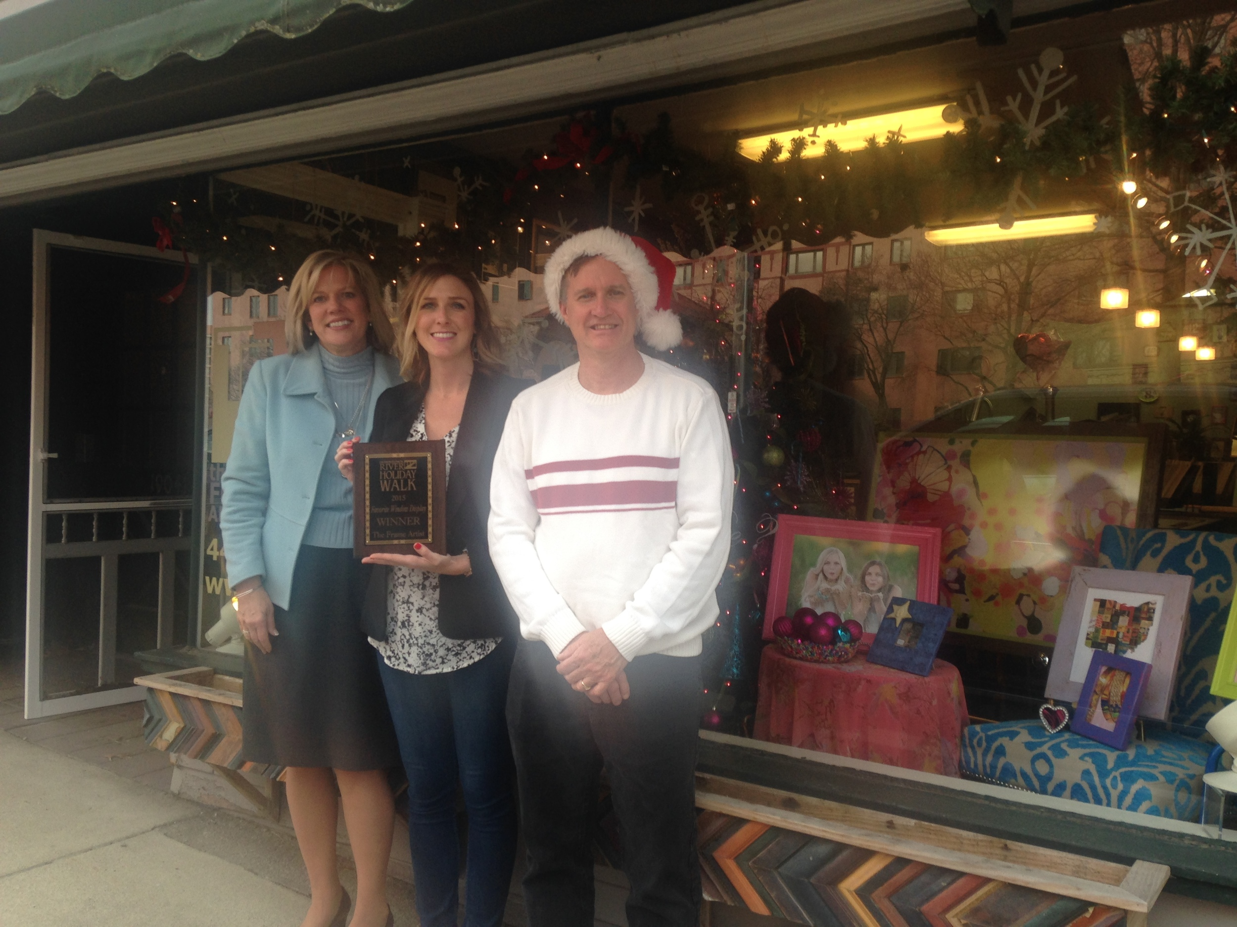 City of Rocky River Mayor Bobst, contest winner Amy Baumberger of The Frame Artist and Holiday Walk Coordinator Bill Brink