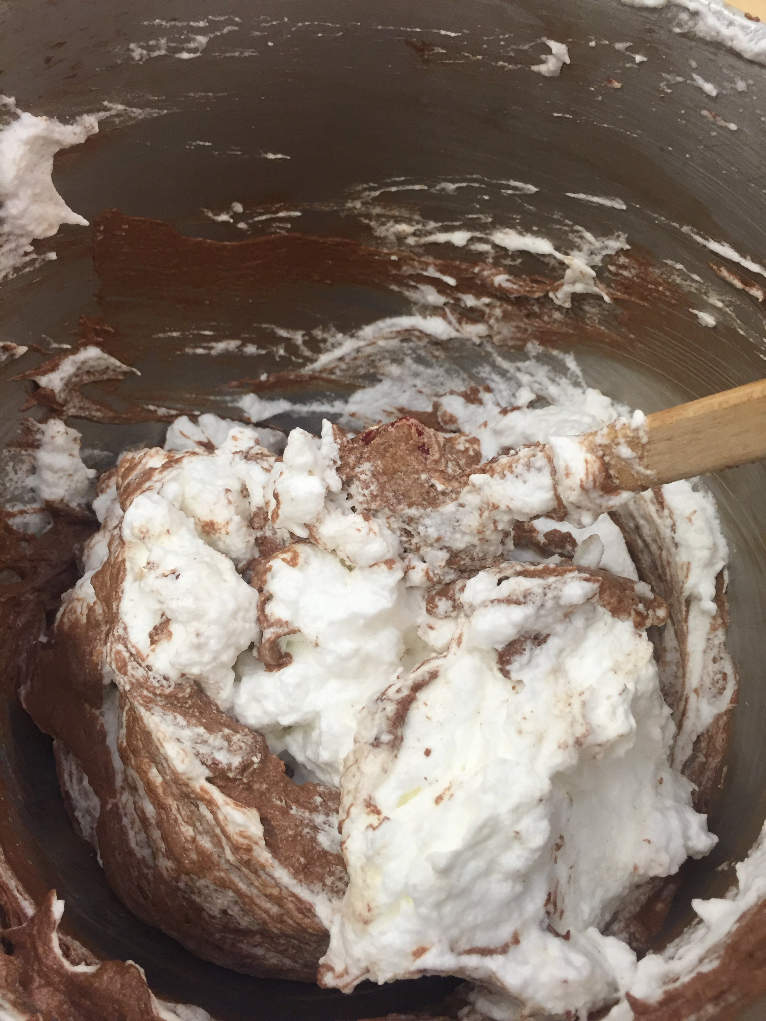 Folding the egg whites into the chocolate cake batter