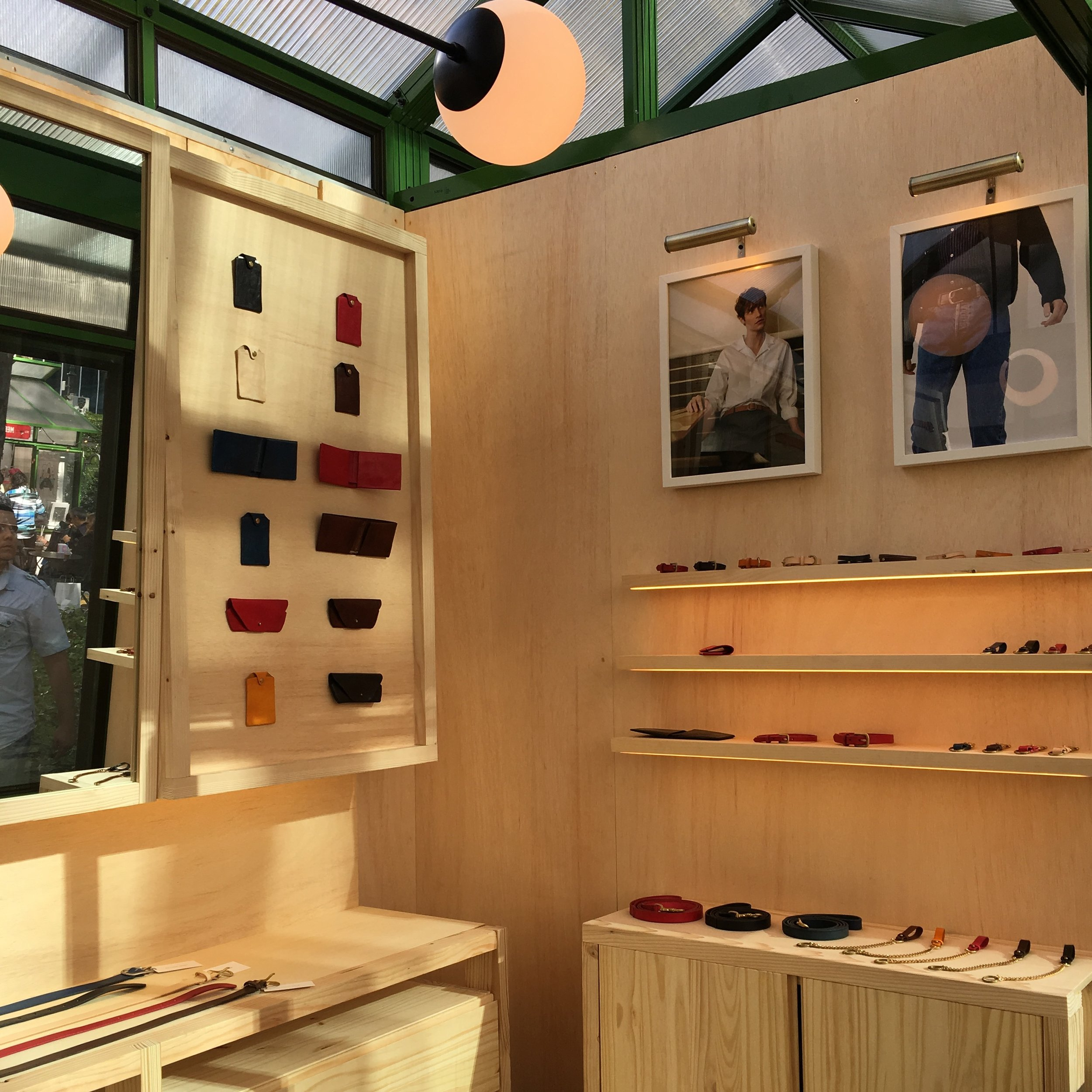 Design and build out of a small pop-up store for leather goods company  Maximum Henry .Located in a glass kiosk at the holiday market in Bryant Park, NYC over the 2017/2018 holiday season.